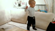 little baby boy jumping on sofa and having fun video