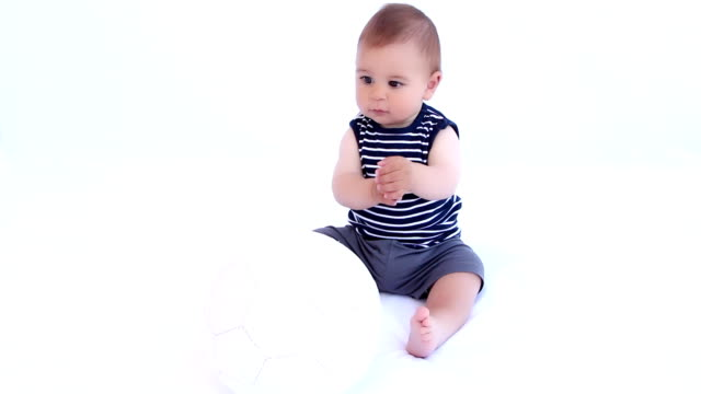 Little baby boy play with soccer ball video