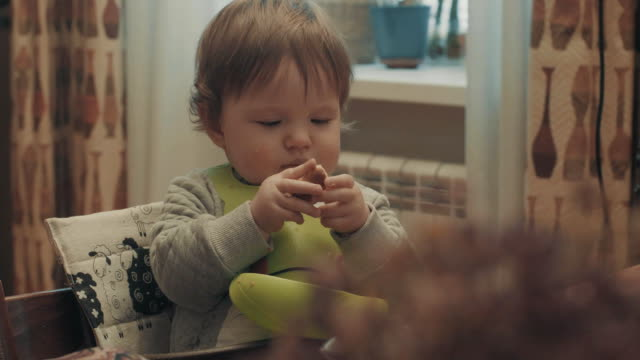 Little baby eating bread video