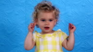 Little baby girl showing nose, eyes, ears, mouth, tongue with finger video