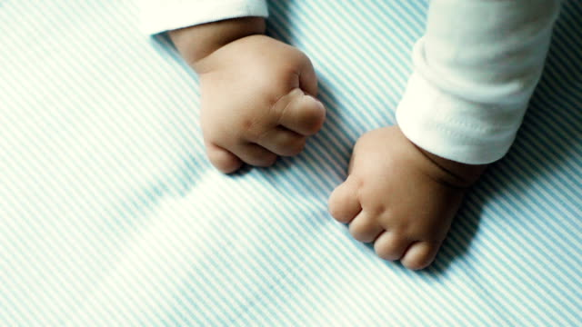 Little baby hands close-up video