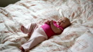 little baby lying on the bed and laughing video