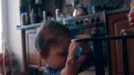 Little baby playing near the table video