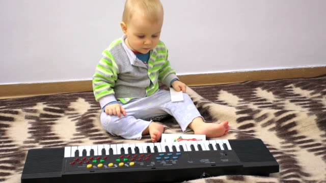 Little baby with electric piano video
