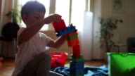 Little boy and building blocks video