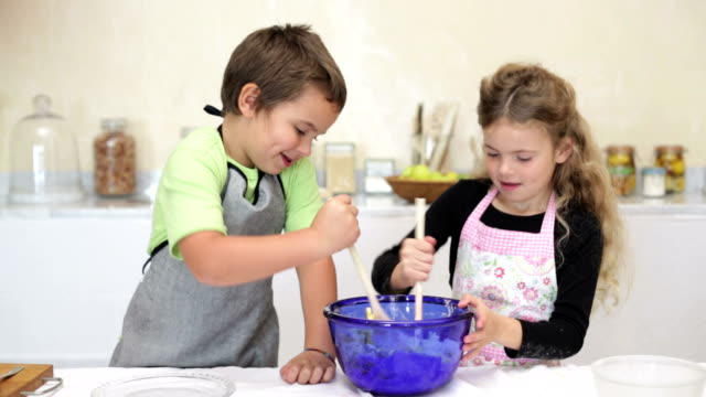 Little boy and his sister baking video