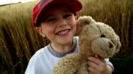 Little boy and his teddy friend video