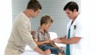 Little boy at a medical visit video