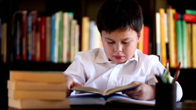 little boy beeing bored with reading video