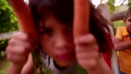 Little boy being silly with two carrots and his friends video