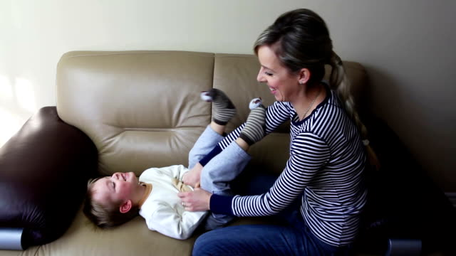 Little Boy being Tickled by Mother video