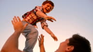 SLO MO Little boy being tossed up at sunset video