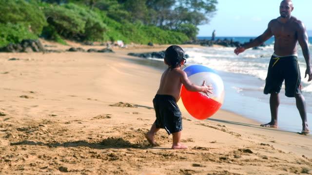 LIttle boy chases beach ball video