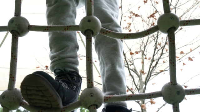 Little boy climbing at the playground video