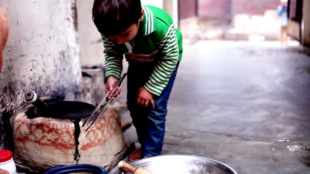 Little boy cooking food video