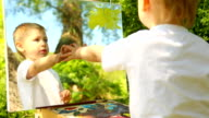 little boy drawing on nature video