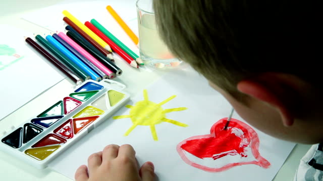 Little Boy Draws Paints video
