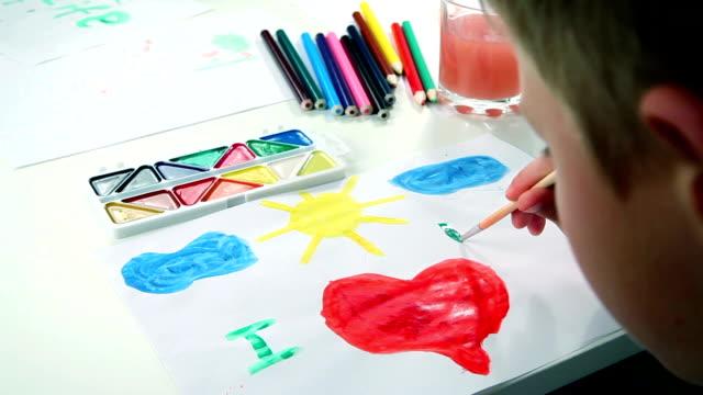 Little Boy Draws Paints video