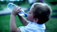 Little boy drinking water video