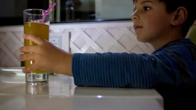 little boy drinks juice video