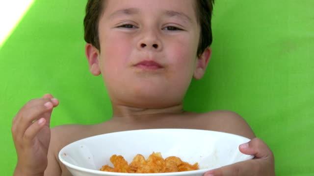 Little boy eating chips video