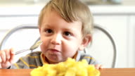 Little Boy Eating Potatoes video