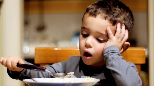 little boy eating soup video