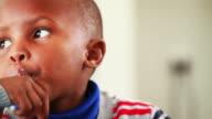 Little boy eats breakfast video