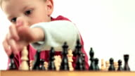 Little boy fascinated by the game of chess. Small genius. video