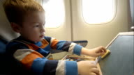 Little boy in the plane with wooden box video