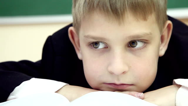 little boy is bored at a lesson at school 2 video