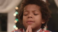 Little boy is praying to God. video