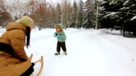 Little boy is trying to sledge his mother video