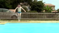 Little Boy Jumping Into An Outdoor Swimming Pool Not Afraid Of The Water video