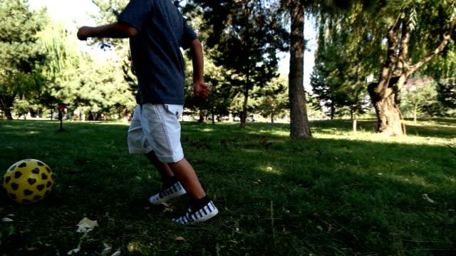 Little Boy Kicking The Ball video