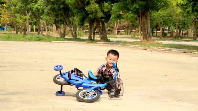 Little boy learns to ride bike video