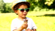 Little boy licking ice cream in a cone video