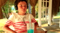 Little boy listening to music at the cafe video