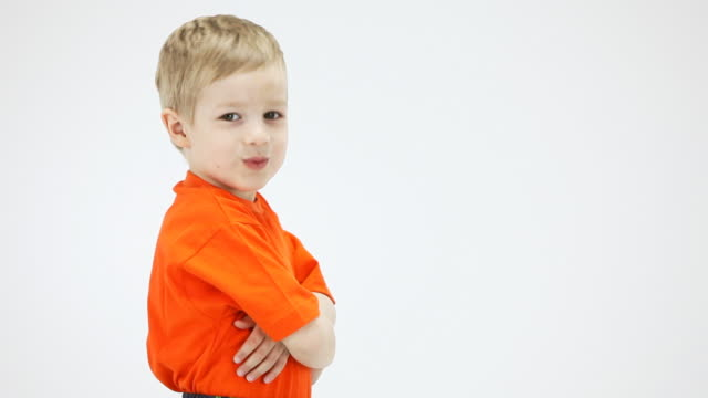 Little boy nods approvingly, shows thumbs up video