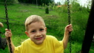 Little boy on a swing video