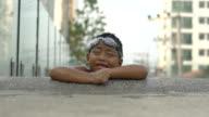 Little boy on swimming pool edge slowmotion video