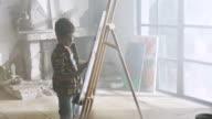 Little boy painting video