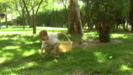 Little boy picking up easter eggs video