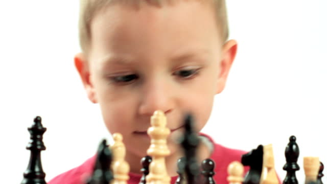 Little boy playing chess. Small genius. video