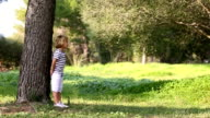 Little boy playing hide and seek video