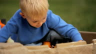 Little Boy Playing in Sandbox video