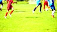 Little boy playing soccer. video