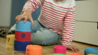 Little Boy Playing With Stack Cups video