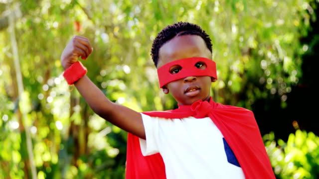 Little boy posing in costume of superhero video