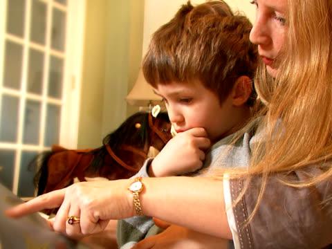 Little boy reads with mum video